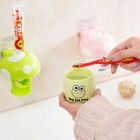Set: Cartoon Toothpaste Dispenser + Toothbrush Cup 1596
